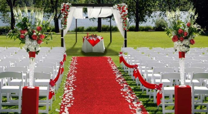 Red carpet for outdoor wedding