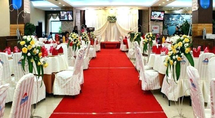 Red carpet for wedding aisle