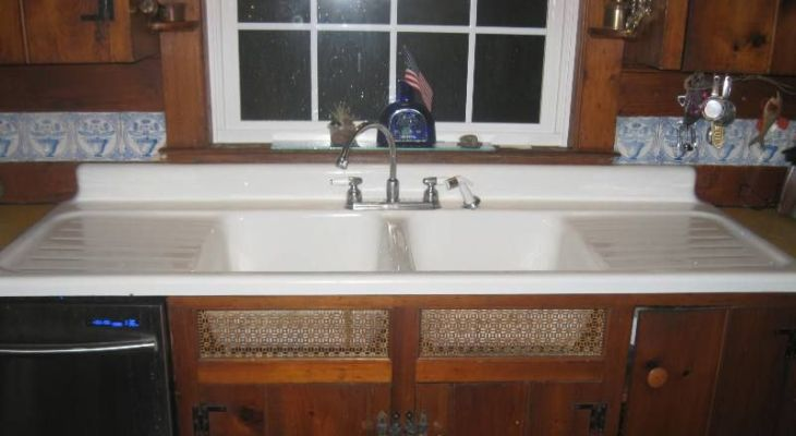 Antique porcelain kitchen sink with drainboard