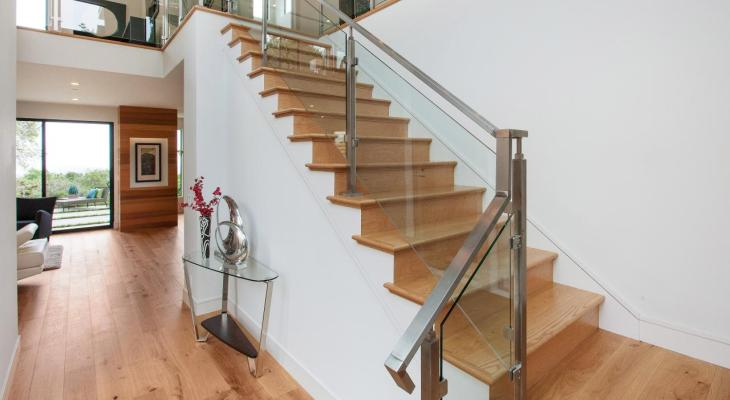 Wooden stairs railing design with glass